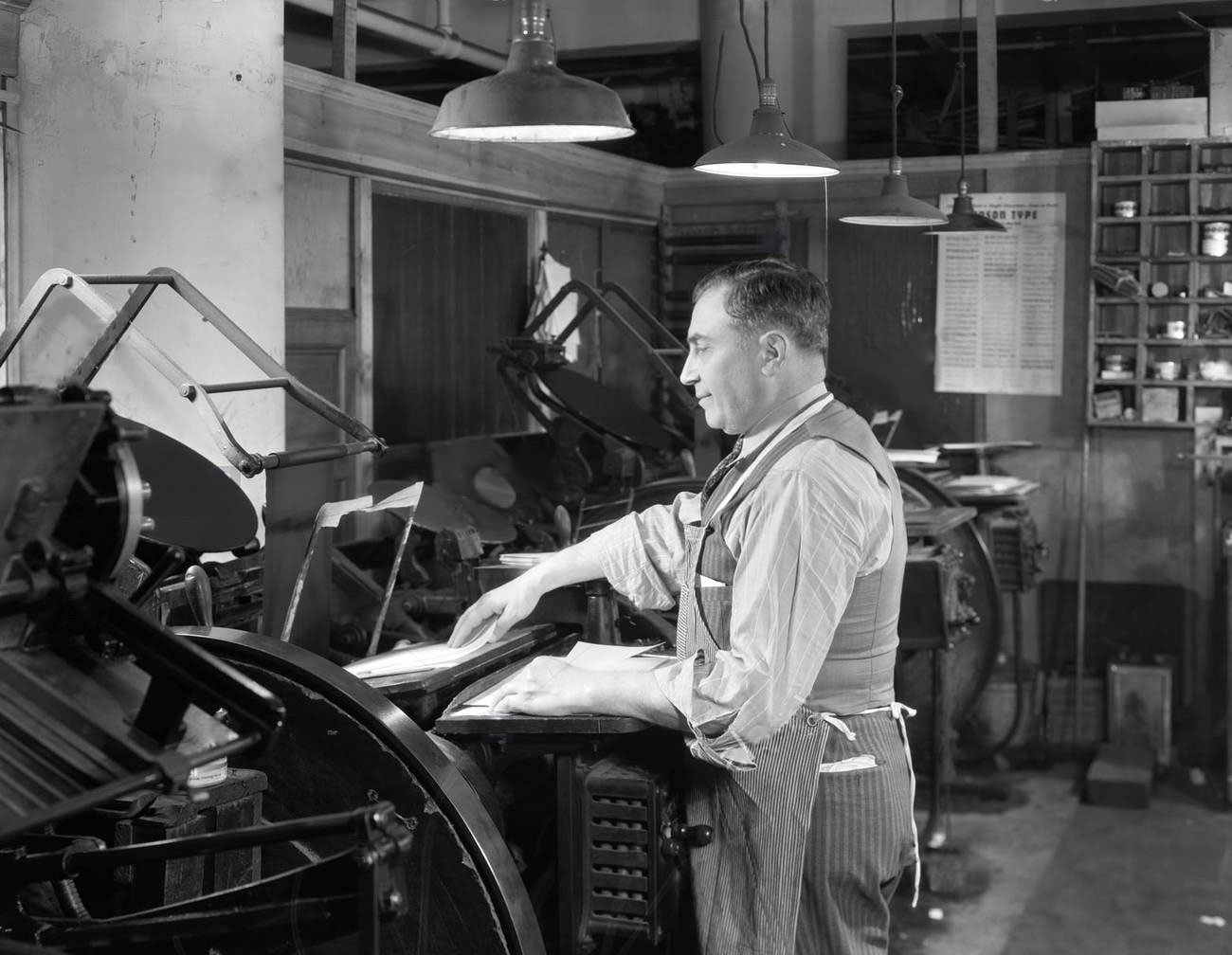 1930s 1940s smiling man worker in print shop hand feeding paper sheet CTG1FM 1 11