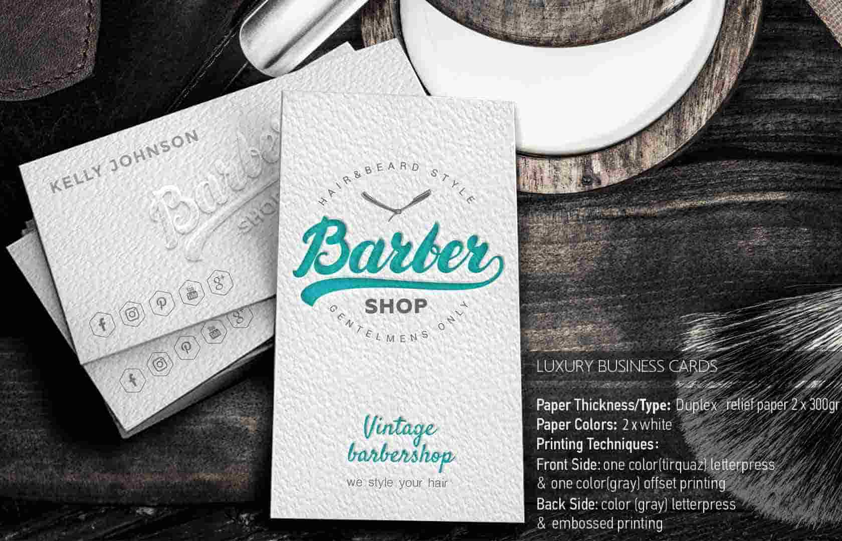 White business card with leterpress printing.